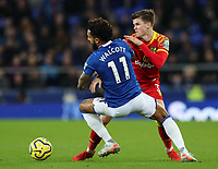 23rd  November 2019; Goodison Park , Liverpool, Merseyside, England; English Premier League Football, Everton versus Norwich City; Sam Byram of Norwich City wins the ball from Theo Walcott of Everton - Strictly Editorial Use Only. No use with unauthorized audio, video, data, fixture lists, club/league logos or 'live' services. Online in-match use limited to 120 images, no video emulation. No use in betting, games or single club/league/player publications