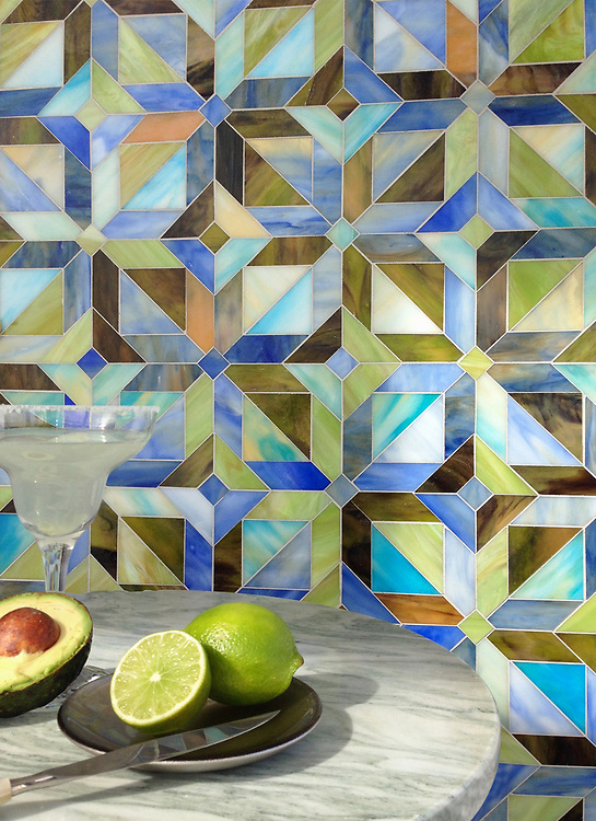 Rubrik, a jewel glass waterjet mosaic shown in Olivine, Aquamarine, Peridot, Blue Onyx, and Chalcedony, is part of the Parquet Line by New Ravenna.