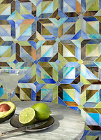 Rubrik, a jewel glass waterjet mosaic shown in Olivine, Aquamarine, Peridot, Blue Onyx, and Chalcedony, is part of the Parquet Line by Sara Baldwin for New Ravenna Mosaics.