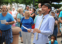 NWA Democrat-Gazette/ANDY SHUPE<br /> Stephen Coger, director of the Arkansas Justice Collective, laughs Saturday, June 17, 2017, during the Don't Deport Dad! rally in front of the Fayetteville Towncenter. Ozark Indivisible and the Arkansas Justice Collective partnered to organize the rally to pressure the Washington County Sheriff's Office to end its efforts to assist Federal agencies in the deportation of residents.
