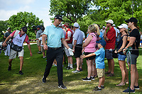 Justin Rose (GBR) high fives a young fan on his way to the tee on 3 during round 2 of the 2019 Charles Schwab Challenge, Colonial Country Club, Ft. Worth, Texas,  USA. 5/24/2019.<br /> Picture: Golffile   Ken Murray<br /> <br /> All photo usage must carry mandatory copyright credit (© Golffile   Ken Murray)