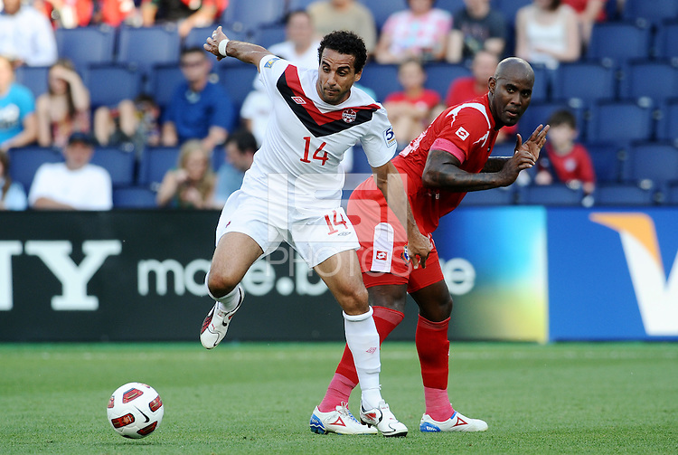 Dwayne De Rosario (14) forward Canada goes around Felipe Baloy Panama...Canada and Panama played to a 1-1 tie in Gold Cup play at LIVESTRONG Sporting Park. Kansas City Kansas.