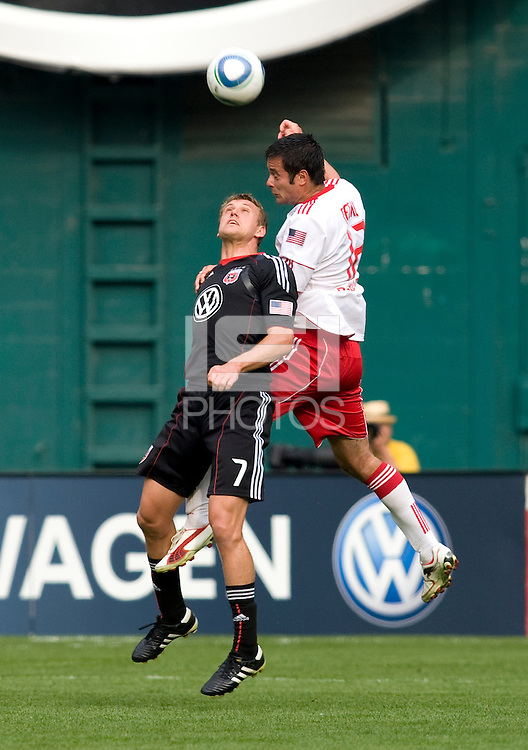 Adam Cristman (7) of D.C. United goes up for a header against Mike Petke (12) of the New York Red Bulls at RFK Stadium in Washington, DC.  The New York Red Bulls defeated D.CC United, 2-0.