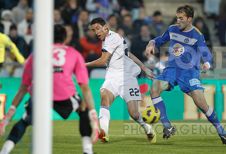 Getafe's Mario Alvarez and Real Madrid's Angel Di Maria during la Liga match