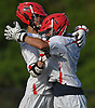 Kyle Bockelman #1, Hills East goalie, right, gets congratulated by teammate Chase LaBarbara #26 after the Thunderbirds' 11-9 win over Commack in the Suffolk County varsity boys lacrosse Division I (Class A) quarterfinals at Half Hollow Hills High School East on Friday, May 19, 2017. Bockelman made 17 saves in the victory.
