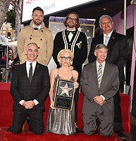 HOLLYWOOD, CA - JANUARY 8: (Standing) Joel McHale, Bryan Fuller, Jeff Zarrinnam, (kneeling) Max Mutchnick, Gillian Anderson, and Leron Gubler as Gillian Anderson is honored with a star on The Hollywood Walk of Fame on on January 8, 2018 in Los Angeles, California. (Photo by Frank Micelotta/Fox/PictureGroup)