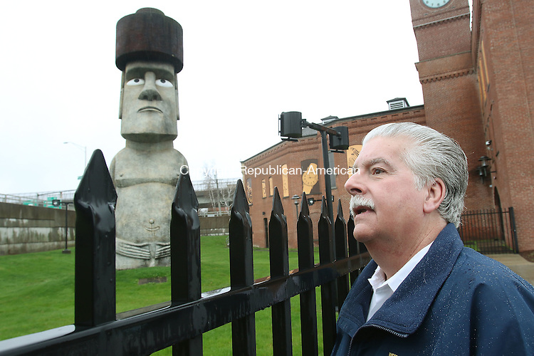 WATERBURY CT. 12 April 2016-041216SV02-Developer Ralph Monti of Wolcott wants to preserve the Easter Island statue outside the former Timex museum in Waterbury. Monti stands by the statue in Brass Mill Commons Tuesday.<br /> Steven Valenti Republican-American
