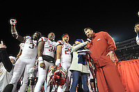 NWA Democrat-Gazette/MICHAEL WOODS • @NWAMICHAELW<br /> University of Arkansas players (from left Arkansas running back Alex Collins (3) Scottie Thurman (31) and Chris Saunders (29) celebrate with coach Bret Bielema celebrate following the Razorbacks 45-23 win over Kansas State in the 57th annual AutoZone Liberty Bowl January 2, 2016.