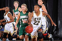 11 November 2011:  FIU's Jerica Coley (22) drives down the court in the second half as the FIU Golden Panthers defeated the Jacksonville University Dolphins, 63-37, at the U.S. Century Bank Arena in Miami, Florida.