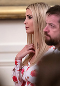 """First Daughter and Advisor to the President Ivanka Trump listens as United States President Donald J. Trump makes remarks on """"America's Environmental Leadership"""" in the East Room of the White House in Washington, DC on Monday, July 8, 2019.<br /> Credit: Ron Sachs / CNP"""