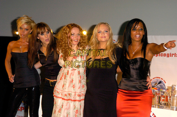 THE SPICE GIRLS - VICTORIA BECKHAM, MELANIE CHISHOLM, GERI HALLIWELL, EMMA BUNTON & MELANIE BROWN.The Spice Girls Re-Union for a World Tour Press Conference, O2 Arena, London, England..June 28th, 2007.posh sporty ginger baby scary half length black strapless top cleavage shirt red dress skirt summery floral print orange pregnant hand on hip pointing leather trousers.CAP/CAN.©Can Nguyen/Capital Pictures