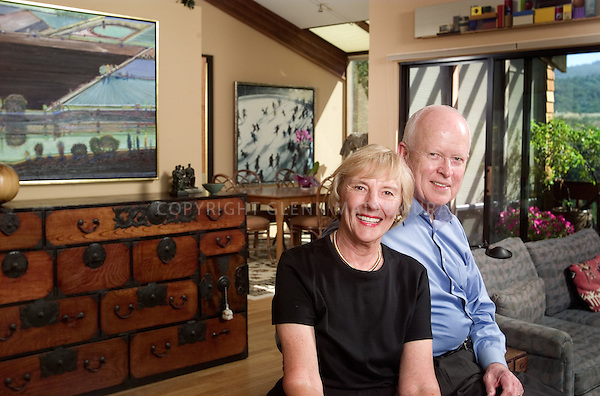 DeeDee and Burt McMurty with art collection at home.