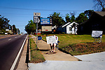 "A woman is covered by a sign reading ""We Need Practice Rounds"" along Washington Road just miles from Augusta National Golf Course on The Masters Golf Tournament's second practice day in Augusta, Georgia April 6, 2010."