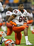 Illinois Fighting Illini defensive tackle Michael Buchanan (99) stretching before the 2010 Texas  Bowl football game between the Illinois  Fighting Illini and the Baylor Bears at the Reliant Stadium in Houston, Tx. Illinois defeats Baylor 38 to 14....