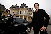 Mikhail Prokhorov, Russia's richest man in 2009, poses in front of his Maybach car at his country residence outside central Moscow. Prokorov made his fortune in investments. In 2009 Forbes estimates his net worth to be USD9.5 billion, making him the world's 40th richest person. Prokhorov is a bachelor and loves kickboxing..Prokhorov sold his 25% stake in Norilsk Nickel to fellow billionaire Oleg Deripaska. He also stepped down as general director of metals outfit Norilsk two year ago after being detained on suspicions that he allegedly made prostitutes available to guests he was entertaining in the glitzy French ski resort Courchevel; though he was never charged. Soon after that, he split with his longtime partner, Vladimir Potanin.