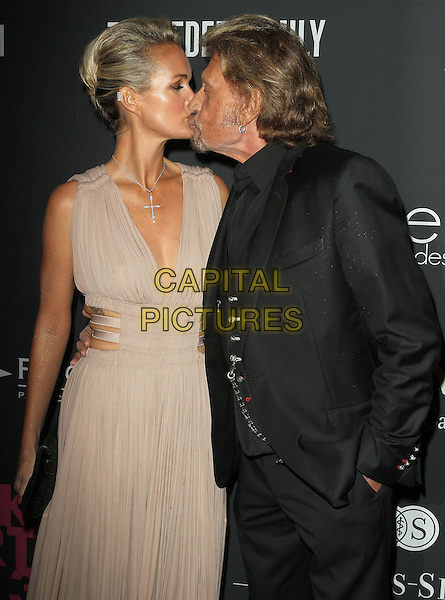 Laeticia Hallyday, Johnny Hallyday<br /> The Pink Party 2013 held at the Santa Monica Airport, Santa Monica, California, USA.<br /> October 19th, 2013<br /> half length dress clutch bag suit couple kiss kissing black goatee facial hair beige <br /> CAP/ADM/KB<br /> &copy;Kevan Brooks/AdMedia/Capital Pictures