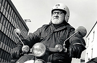 Elderly man riding a moped, Nottingham UK 1989