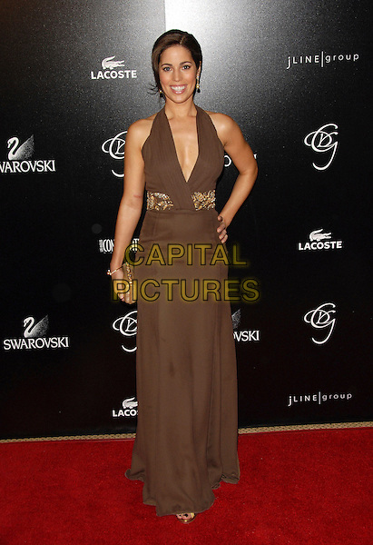 ANA ORTIZ.Attends The 9th Annual Costume Designers Guild Awards Gala held at The Beverly Wilshire Hotel in Beverly Hills, California, USA, February 17 2007..full length brown dress halterneck low cut hand on hip.CAP/DVS.©Debbie VanStory/Capital Pictures