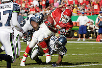 Chiefs running back Larry Johnson (27) scores a touchdown as he is hit by Seattle Seahawks Leroy Hill (56) and Ken Hamlin (26) to give Kansas City the lead at the half at Arrowhead Stadium  in Kansas City, Missouri on October 29, 2006. The Chiefs led 20-14 at the half.