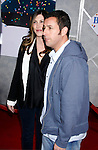 "HOLLYWOOD, CA. - December 18: Actor Adam Sandler and wife Jackie Sandler arrive at the Los Angeles premiere of ""Bedtime Stories"" at the El Capitan Theatre on December 18, 2008 in Hollywood, California."
