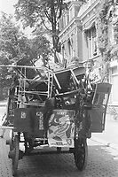 Photo from the NIOD's Huizinga collection. Two boys on a horse cart full of furniture after the liberation.