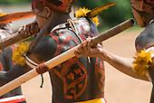 Xingu Indigenous Park, Mato Grosso State, Brazil. Aldeia Afukuri (Kuikuro). Festival of Taquara, warriors playing Taquara bamboo flutes.