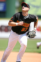 May 13, 2009:  First Baseman Justin Huber of the Rochester Red Wings, International League Class-AAA affiliate of the Minnesota Twins, in the field during a game at Frontier Field in Rochester, FL.  Photo by:  Mike Janes/Four Seam Images