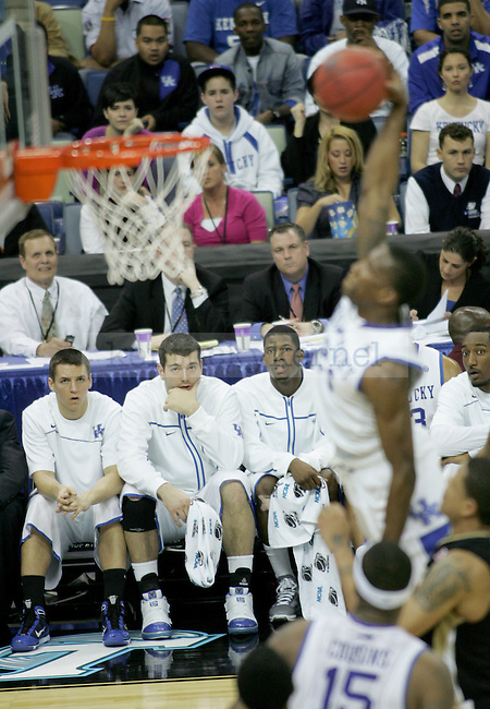 The benched players watch as freshman guard Eric Bledsoe makes a dunk during the second half of the UK men's basketball against Wake Forest for the second round of the NCAA tournament at New Orleans Arena on Saturday, March 20, 2010. The Cats won 90-60 over the Deacs. Photo by Adam Wolffbrandt | Staff