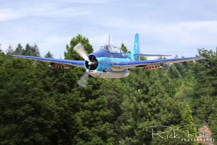 Grumman TBM-3 Avenger, bu85983, piloted by Chuck Wentworth makes a pass down the flight line during the 2009 Grass Valley Airfest held at the Nevada County Airport in California's gold country. This aircraft, like many of the former World War II torpedo bombers saw duty as sprayers and aerial firefighting platforms.