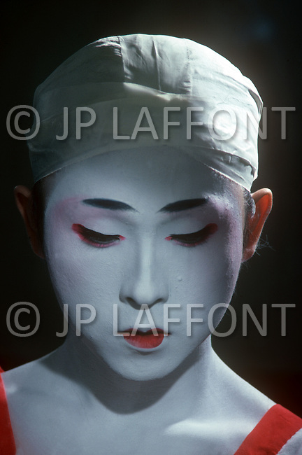October, 1980. Tokyo, Japan. The men of the Kabuki Theater prepare for their performance with rehersal and makeup application.