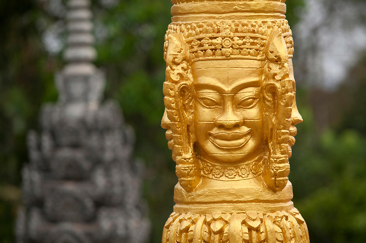 A Bayon style grave markers in Phnom Penh, Cambodia. <br /> <br /> Photos &copy; Dennis Drenner 2013.