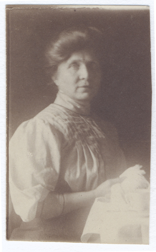 20a. (cont.)<br /> <br /> part of a subject whose whole is unknown<br /> <br /> 2 5/16 x 1 9/16 [sepia]<br /> <br /> figure in profile in light pleated blouse with three-quarter muttonchop sleeves, left hand holding a fan; part of sleeve to right is probably Sam Crone&rsquo;s&mdash;right piece of unknown whole<br /> <br /> verso<br /> in hand of Elsa Steiner Huff, vertically along right edge<br /> Aunt Sadie Crone
