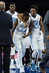 02 APR 2016: Forward Theo Pinson (1) and Guard Kenny Williams (24) of the University of North Carolina embrace after defeated Syracuse University during the 2016 NCAA Men's Division I Basketball Final Four Semifinal game held at NRG Stadium in Houston, TX.   North Carolina defeated Syracuse 83-66 to advance to the championship game.  Brett Wilhelm/NCAA Photos