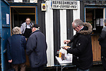 Supporters at the refreshment kiosk before Atherton Collieries played Boston United in the FA Trophy third qualifying round at the Skuna Stadium. The home club were formed in 1916 and having secured three promotions in five season played in the Northern Premier League premier division. This was the furthest they had progressed in the FA Trophy and defeated their rivals from the National League North by 1-0, Mike Brewster scoring a late winner watched by a crowd of 303 spectators.