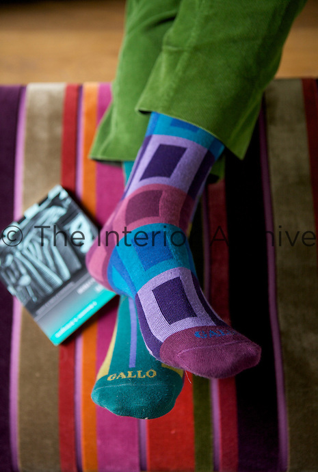 Seen against the stripes of the velvet ottoman in the living room one of Paolo Bagnara's colourful sock designs