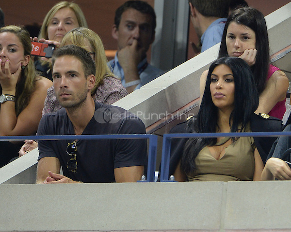FLUSHING NY- SEPTEMBER 08: Simon Huck and Kim Kardashian are sighted watching Serena Williams Vs Venus Williams on Arthur Ashe Stadium at the USTA Billie Jean King National Tennis Center on September 8, 2015 in Flushing Queens. Credit: mpi04/MediaPunch