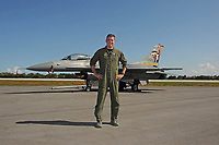 FORT LAUDERDALE FL - MAY 04: Maj John Waters stands next too U.S. Air Force F-16 Viper as it sits on the tarmac at Fort Lauderdale Executive Airport during Fort Lauderdale Air Show Media day on May 4, 2017 in Fort Lauderdale, Florida. Credit: mpi04/MediaPunch