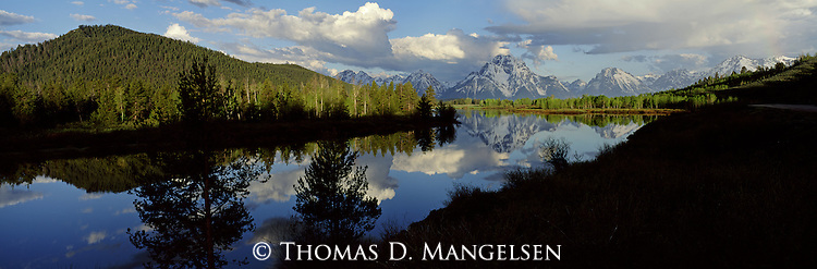 Mount Moran reflects in the still waters of the Snake River at Oxbow Ben in Grand Teton National Park, Wyoming.