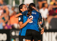 Kansas City, MO - Sunday July 02, 2017:  Shea Groom is embraced Lo'eau Labonta after scoring a goal during a regular season National Women's Soccer League (NWSL) match between FC Kansas City and the Houston Dash at Children's Mercy Victory Field.