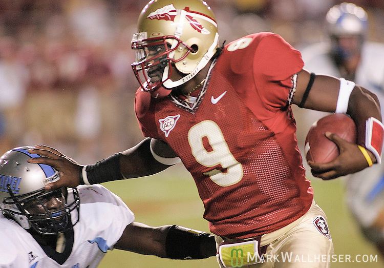 Florida State quarterback Xavier Lee (9) stiff arms a Citadel defender on his way to his first collegiate running touchdown September 10, 2005.  .Florida State defeated the Citadel 62-10 at Bobby Bowden Field in Tallahassee, Florida.