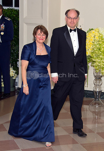 United States Senator Amy Klobuchar (Democrat of Minnesota) and John Bessler arrive for the State Dinner in honor of Prime Minister Trudeau and Mrs. Sophie Gr&Egrave;goire Trudeau of Canada at the White House in Washington, DC on Thursday, March 10, 2016.<br /> Credit: Ron Sachs / Pool via CNP/MediaPunch