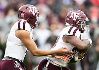 ATHENS, GA - NOVEMBER 23: Kellen Mond #11 hands the ball off to Kam Brown #18 of the Texas A