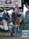 Spencer Wright competes in the saddle bronc riding event at the Reno Rodeo in Reno, Nev., on Friday, June 20, 2014.<br />