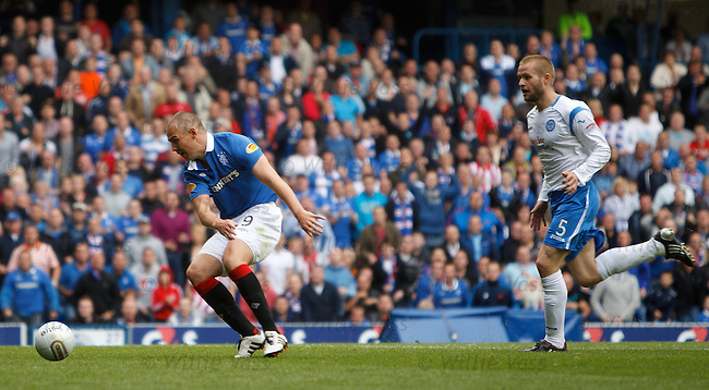 Kenny Miller leaves defender Kevin Rutkiewicz trailing in his wake as he shots in Rangers second goal