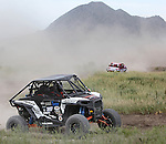 Mike Slawson works his way around the course at the beginning of the Buffalo Chip 100 off-road racing event Saturday at the T.O.R.C. track in Sturgis, S.D.(Photo by Richard Carlson/Inertia)