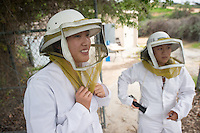 Occidental College associate professor of biology Shana Goffredi and environment health & safety manager Bruce Steele take students to the Fiji Hill bee hives as part of an investigation of bacterial symbionts in honey bees on Jan. 28, 2015.<br /> (Photo by Marc Campos, Occidental College Photographer)