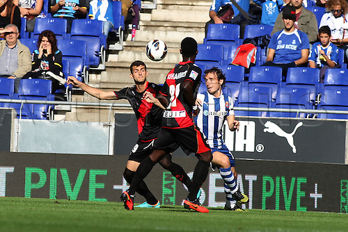 21.10.2012 Barcelona, Spain. Jose Carlos (L) near Verdu (R) in action during the La Liga game between Espanyol and Rayo Vallecano from the Estadi Cornellà-El Prat.