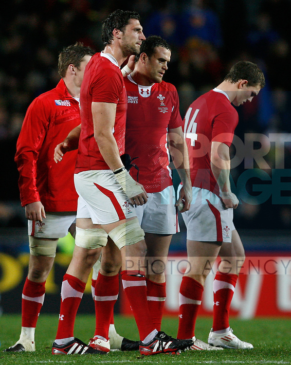 Wales' (L-R) Luke Charteris, Jamie Roberts and George North show their dejection at full time..