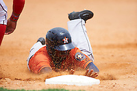 GCL Astros designated hitter Edgar Lorenzo (41) slides head first into third base during a game against the GCL Nationals on August 14, 2016 at the Carl Barger Baseball Complex in Viera, Florida.  GCL Nationals defeated GCL Astros 8-6.  (Mike Janes/Four Seam Images)