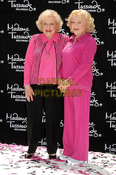 Betty White & Wax Figure.Madame Tussauds Hollywood Unveils Betty White Wax Figure held at Madame Tussauds Hollywood, Hollywood, California, USA..June 4th, 2012.full length black trousers pink top striped stripes  .CAP/ADM/BP.©Byron Purvis/AdMedia/Capital Pictures.